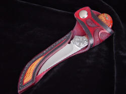 """Pecos II"" sheathed view. Display/Open sheath protects the point and cutting edge while displaying knife form, handle, bolster details and accents. Knife is secure with flap snap retention"