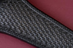 """Raijin"" leather sheath front detail. Hand-stamp tooling is traditional black basketweave, surface is buffed and sealed with acrylic satin finish."