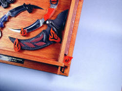 """Raptor"" kerambits case hanger detail. Hangers for Manicouagan are hand-carved bloodwood, match case tension mortise wedges"
