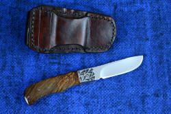 """Sadr"" linerlock folding knife, reverse side view. Sheath back fits standard belt sizes, is hand-stitched with polyester for strength and durability"