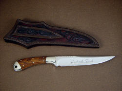 """Sanchez"" fine custom knife, reverse side view. Note custom name etching on blade, and hand carving and tooling on sheath back and belt loop"