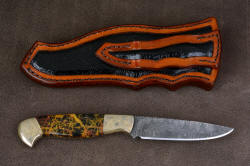 """Tarazed"" reverse side view. Sheath back and belt loop are inlaid with full panels of glazed ostrich leg skin"