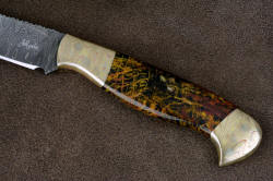 """Tarazed"" obverse side handle view. Striking patterns in blade, bolsters, and gemstone handle blend together"