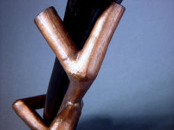 """Tharsis Intense"" knife sheath stand detail shows warm color of cast bronze. Form is solid bronze, cast in one piece."