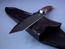 """Tharsis Intense"" point detail. Knife point is angular, sharp, hollow ground and mirror polished hot blued O1 tool steel"