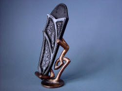 """Tharsis Intense"" sheath and stand, demonstrating singular work of art that is a sheath with bold patterns and texture of natural materials and hand-cast bronze scultpture"