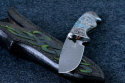 """Thuban"" blade point detail. The drop point is thin and super sharp at the tip, with good belly and blade strength. The sheath is thick and strong."