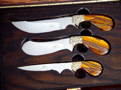 """Trophy Game Set"" close case dedtail. Red oak is antiqued, durable, and houses knives well"