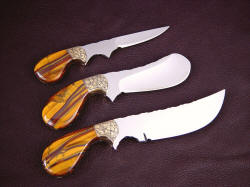 """Trophy Game Set"" reverse side view. Trio of knives all have palm handles, nest in the palm comfortably with finger groove control"