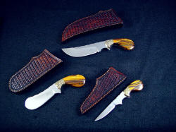 """Trophy Game Set"" with matching sheaths in basket weave leather shoulder"