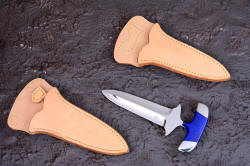 """Vindicator with PSD (Principle Security Detail) type sheaths. These sheaths are undyed and untreated leather to protect expensive clothing"