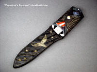 Freedom's Promise, sheathed view, hand carved leather sheath suited to specific knife design and theme