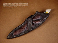 """Santa Fe"" in crossdraw style sheath, worn at an angle on the belt. Sheath is brown lizard skin inlaid in hand-carved leather"