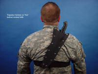 Trapezius harness allows wear of large knife over spine, retention around midline with polypropylene straps