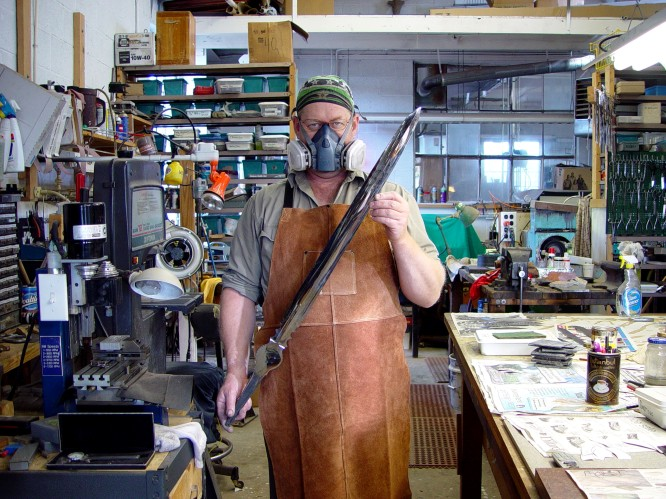 Jay Fisher with mirror finished hollow ground sword blade. Respirator and heavy protection is required in this job!