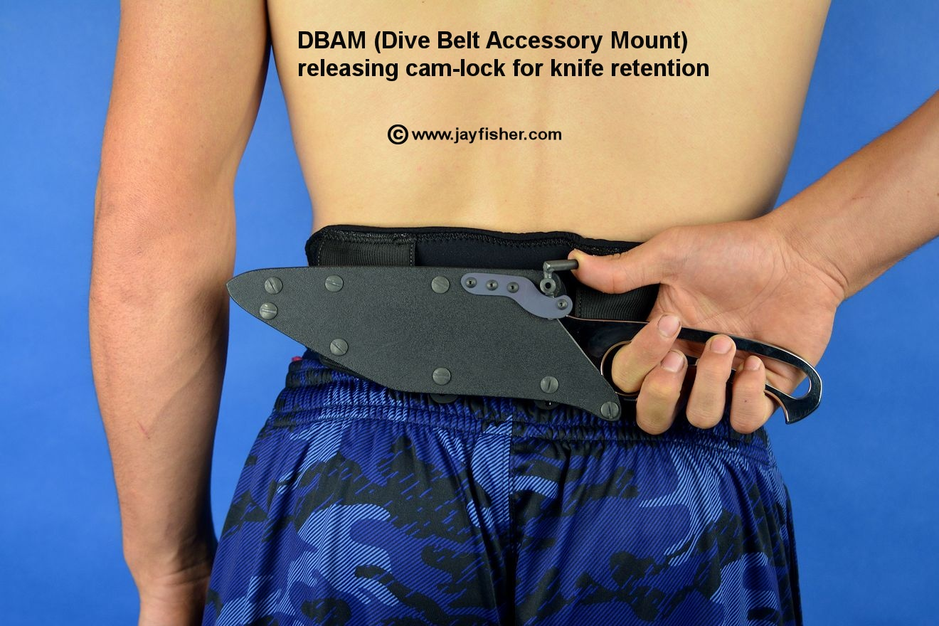 DBAM (Dive Belt Accessory Mount). Release is being operated by thumb pressure on cam lock.