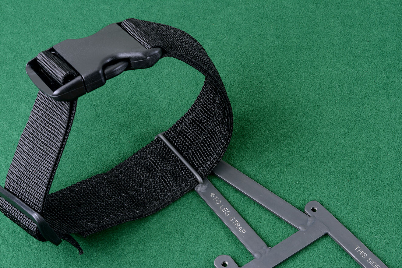 """Ananke"" tactical sheath modular frame component showing leg strap and frame loop"