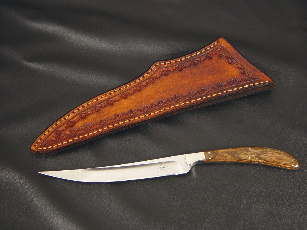 """Boning Knife"" obverse side view in 440C high chromium stainless steel blade, 304 stainless steel bolsters, Dymondwood(stabilized birch laminate) handle, hand-stamped leather sheath"