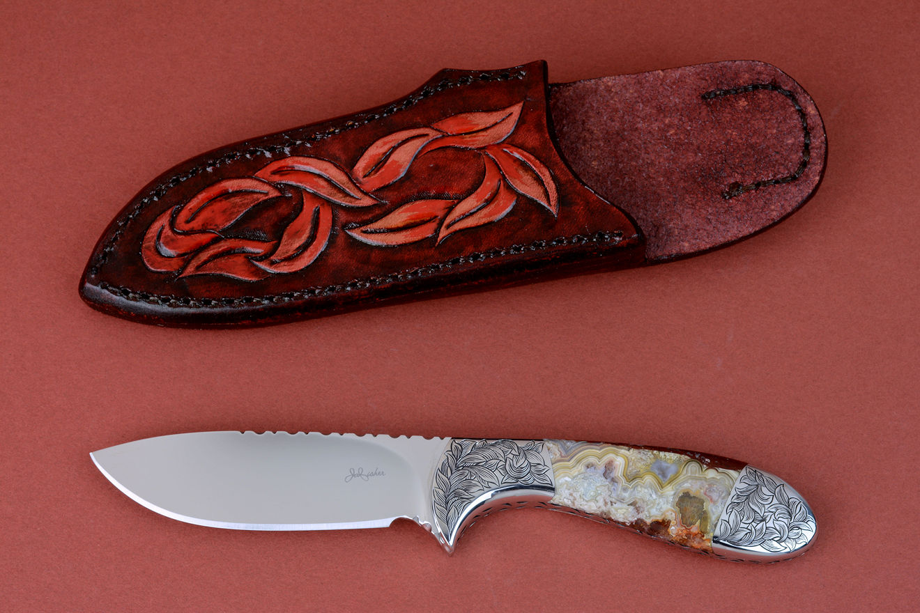 """Chicoma"" obverse side view in 440C high chromium stainless steel blade, hand-engraved 304 stainless steel bolsters, Carnival Crazy Lace Agate gemstone  handle, hand-carved, hand-dyed leather sheath"
