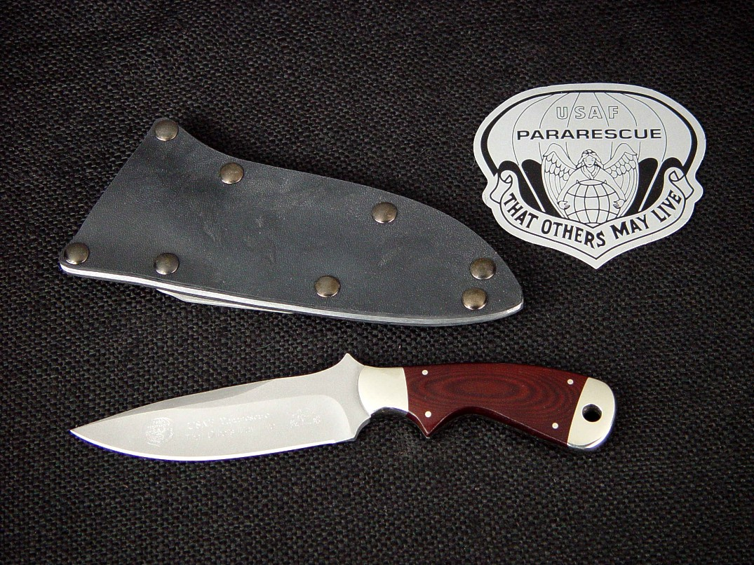 "USAF Pararescue ""Creature"" CSAR tactical knife, obverse side view in bead blasted 440C stainless steel blade, 304 stainless bolsters, burgundy linen micarta phenolic handle, tension kydex, aluminum, blued steel sheath"