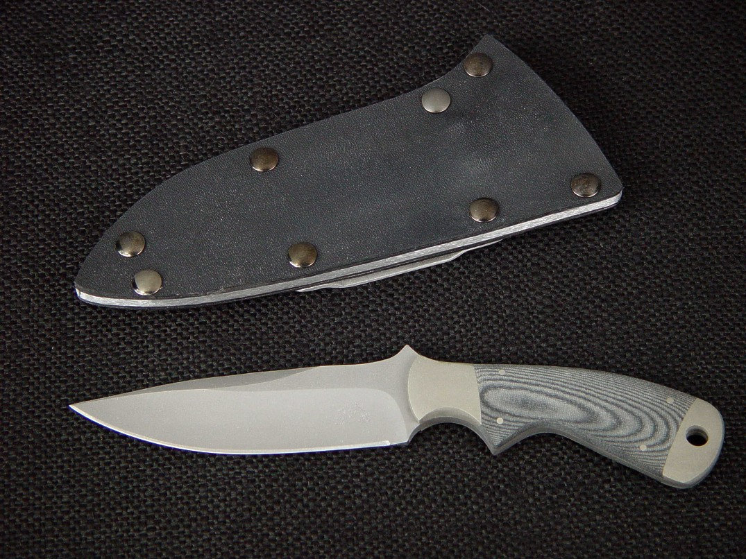 """Creature"" CSAR, tactical knife, obverse side view in bead blasted 440C stainless steel blade, nickel silver bolsters, canvas micarta handle, kydex, aluminum, blued steel sheath"
