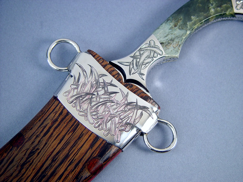 "Hand-engraved, handmade stainless steel components, chape detail in 304 stainless steel in ""Desert Wind"" Persian dagger at Enchanted Spirits Studio"
