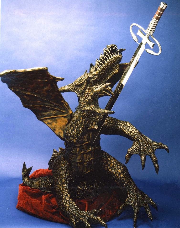 "Dragonslayer-the Taste of Steel: 400 pounds of bronze and a 56"" sword, representing the slaying of the black dragon of cancer"