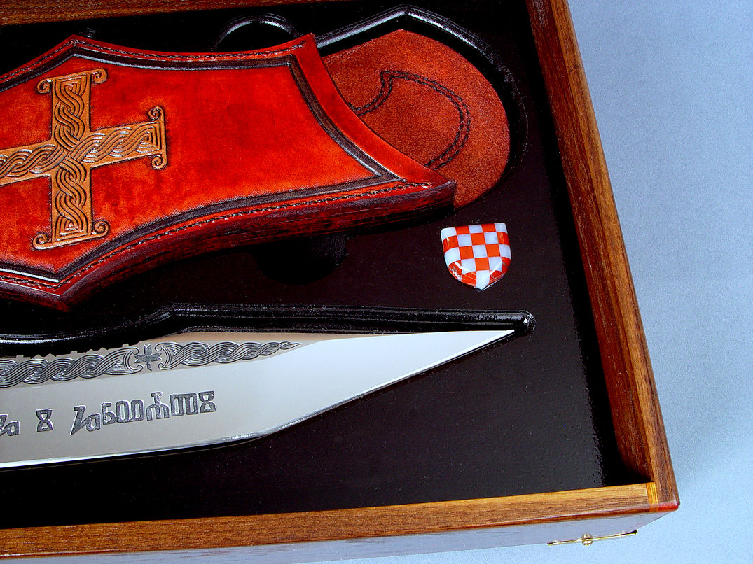 """Duhovni Ratnik"" case details. Shield button is hand-carved Red Jasper and White Agate, 20 pieces of gemstone mosaic."