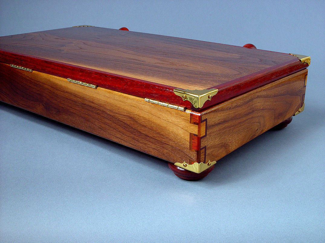 """Duhovni Ratnik"" case back view. Case has brass stopped hinges, lid banding of Paduk hardwood and black walnut throughout"
