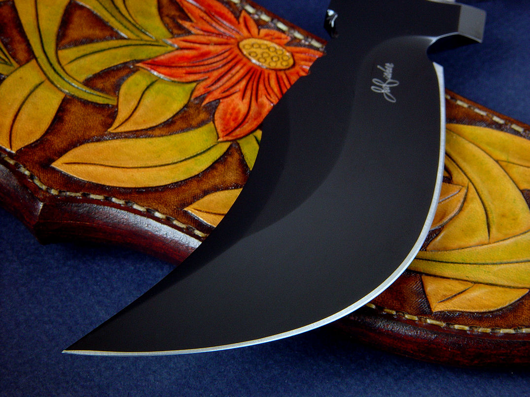 """Flamesteed"" obverse side view in mirror finished, hot blued O1 high carbon tungsten-vanadium tool steel blade, hand-engraved 304 stainless steel bolsters, Bird's Eye Rhyolite gemstone handle, hand-carved, hand-dyed leather sheath"
