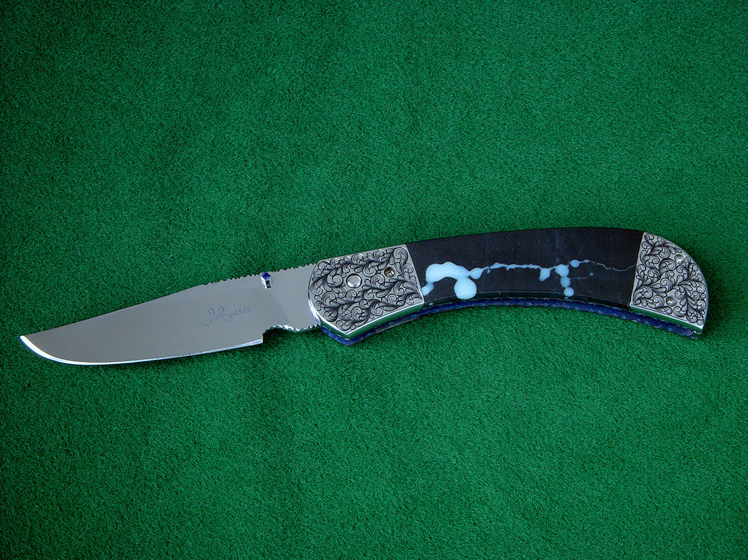 """Gemini"" Liner Lock Folding Knife, obverse side view in 440C high chromium stainless steel blade, hand-engraved 304 stainless steel bolsters, anodized titanium liners, sapphire set thumb studs, case of Black Galaxy Granite gabbric anorothosite"