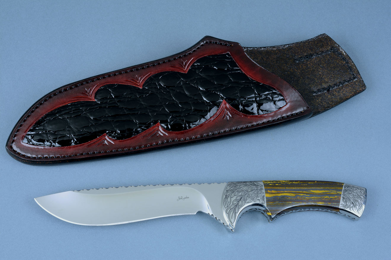 """Golden Eagle"" custom knife, stand view in CPM154CM high molybdenum stainless steel blade, hand-engraved 304 stainless steel bolsters, Australian Tiger Iron gemstone handle, hand-carved, hand-dyed leather sheath inlaid with Caiman skin"