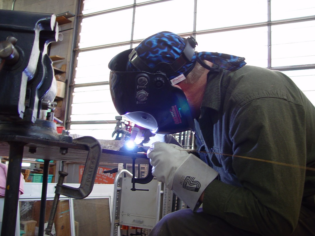 Gas tungsten arc welding in high tech modern art studio and machine shop