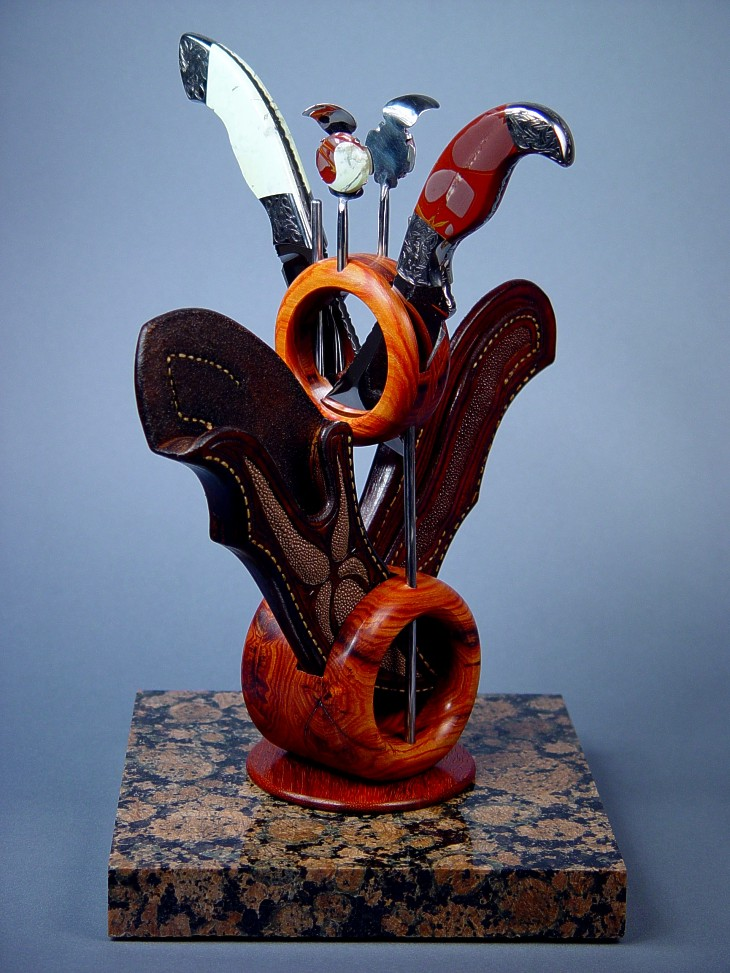 Custom Knife display stand for Izanami, Izanagi knives and sheaths. Stand is granite, tulipwood, 304 stainless steel, Noreena Jasper and Nickel Magnesite gemstone, and Paduk hardwood