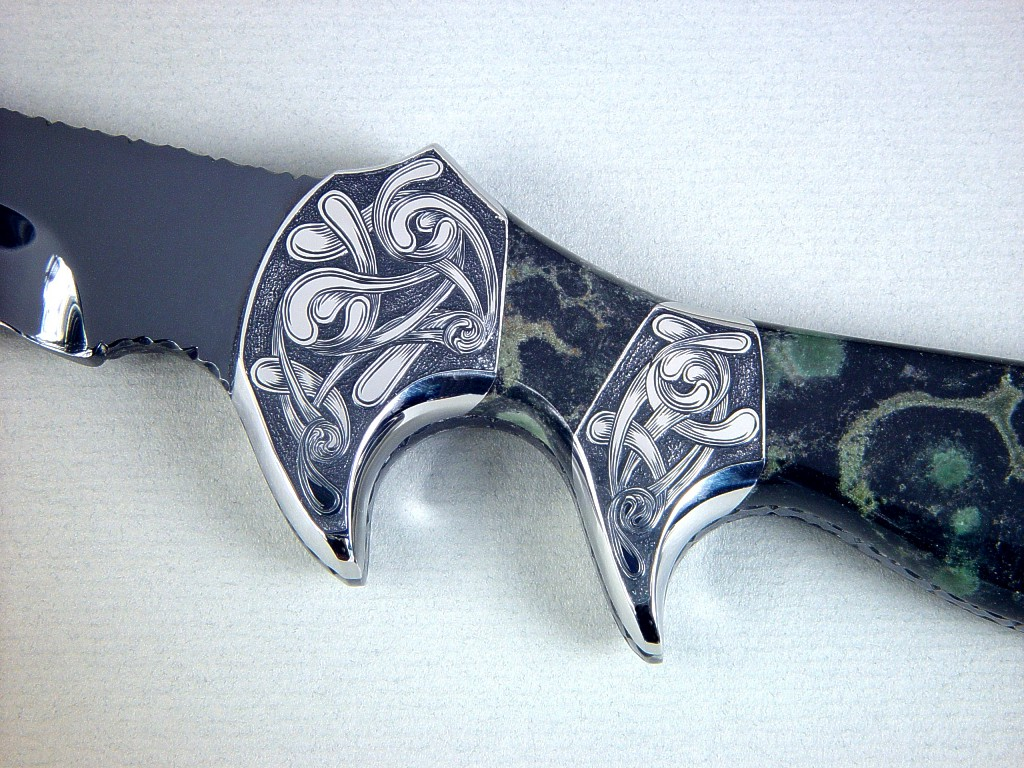 """Ladron"" obverse side view in mirror polished and hot blued O1 high carbon tungsten-vanadium tool steel blade, hand-engraved 304 stainless steel bolsters, Nebula Stone gemstone handle, black stingray skin inlaid in hand-carved leather sheath"