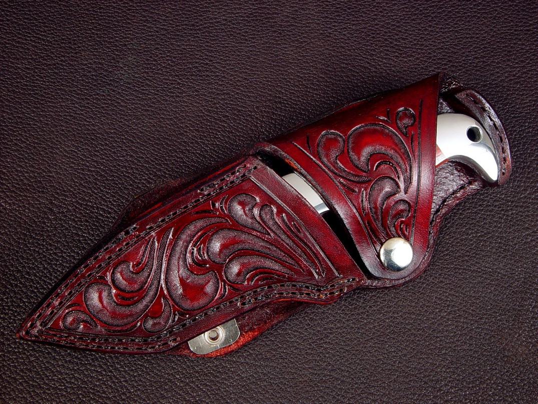 """Last Chance Light,"" sheath view in 440C high chromium stainless steel blade, 304 stainless steel bolsters, Australian Snakeskin Jasper gemstone handle, hand-carved leather horizontal belt sheath"