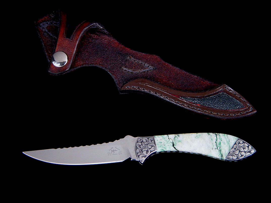 """Little Tusas"" obverse side view in 440C high chromium stainless steel blade, hand-engraved low carbon steel bolsters, Biotite gemstone handle, green rayskin inlaid in hand-carved leather sheath"