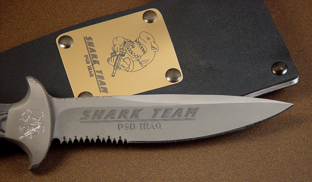 Computer engraving on Principle Security Detail tactical defensive knife in bead blasted 440C stainless steel, stainless bolsters, micarta handle, kydex, aluminum and steel sheath, with brass flashplate