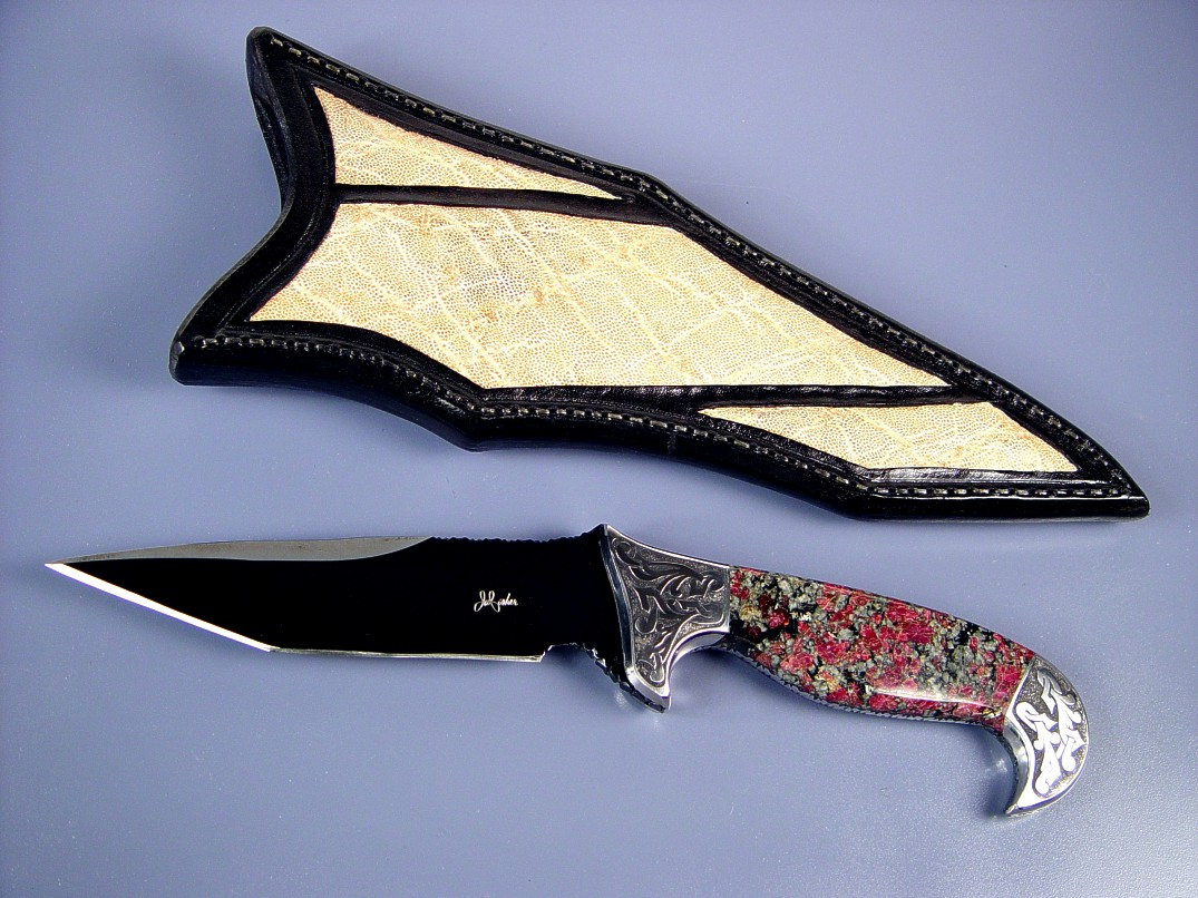 "Fine handmade knife: ""Mercury Magnum"" obverse side view: blued O-1 high carbon alloy tool steel blade, hand-engraved 304 stainless steel bolsters, Eudialite gemstone handle, Elephant skin inalid in hand-carved leather sheath"