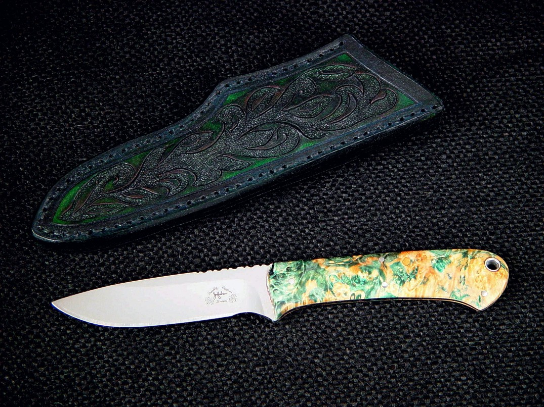 """Mirach,"" obverse side view, in RWL34 high molybdenum stainless steel blade, stabilized box elder burl hardwood handle, hand-carved leather sheath"