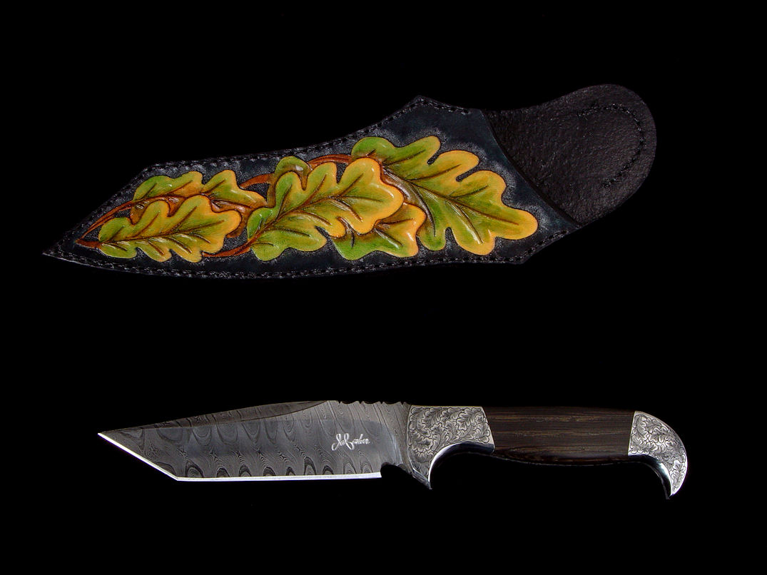 """Morta"" obverse side view in twist damascus pattern welded steel (O1 and A36), hand-engraved 304 stainless steel bolsters, Bog Oak mineralized handle, sheath of hand-dyed, hand-carved leather shoulder."