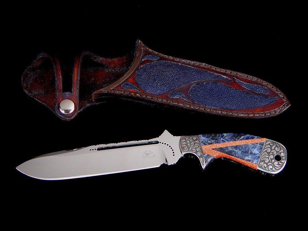 """Mountain Creature"" obverse side view in milled 440C high chromium stainless steel blade, hand-engraved carbon steel bolsters, mosaic gemstone handle of blue sodalite and Italian goldstone, hand-carved leather sheath inlaid with blue rayskin"
