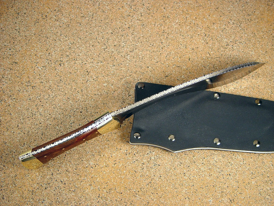 """Nasmyth-Marius"" khukri, obverse side view in satin finished 440C high chromium stainless steel blade, brass bolsters, Honduras Rosewood hardwood handle, kydex, aluminum, steel sheath"