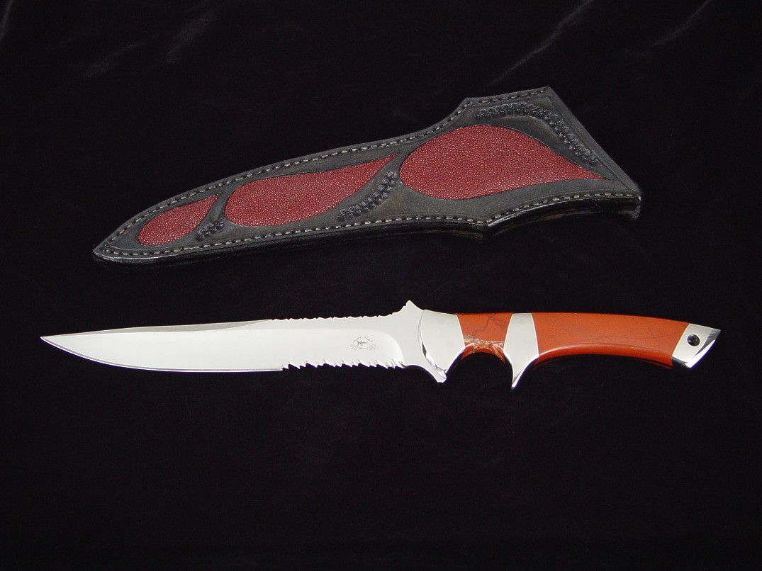 """Patriot"" tactical knife, obverse side view in 440C high chromium stainless steel blade, 304 stainless steel bolsters, Red River Jasper gemstone handle, red stingray skin inlaid in hand-carved leather sheath"