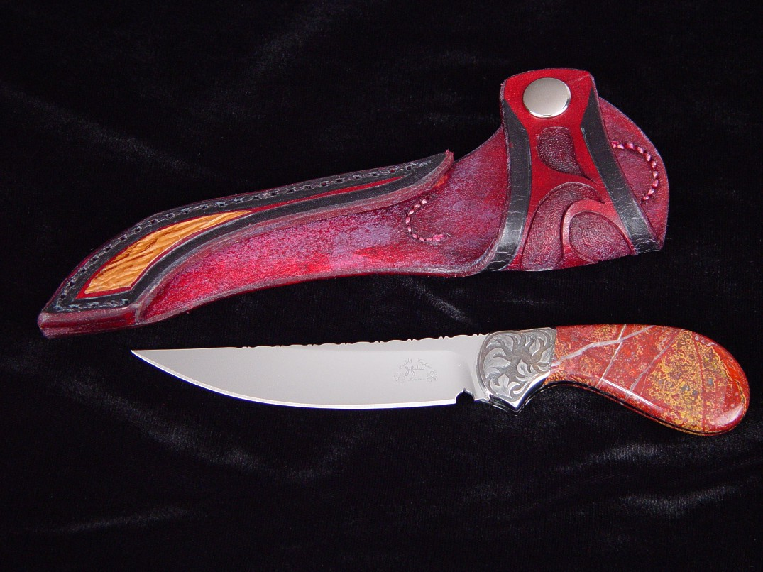 """Pecos II"", obverse side view in ATS-34 high molybdenum stainless steel blade, hand-engraved carbon steel bolsters, New Mexico Jasper gemstone handle, shark skin inlaid in hand-carved leather sheath"