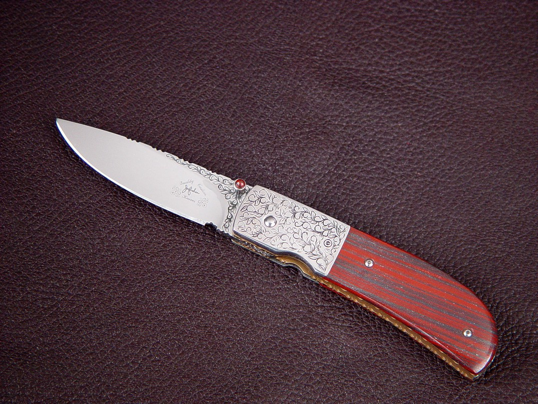 """Polaris"" linerlock folding knife, obverse side view: hand-engraved 440C high chromium stainless steel blade, 304 stainless steel bolsters, jasper and hematite gemstone handle, 6AL4V anodized titanium liners"