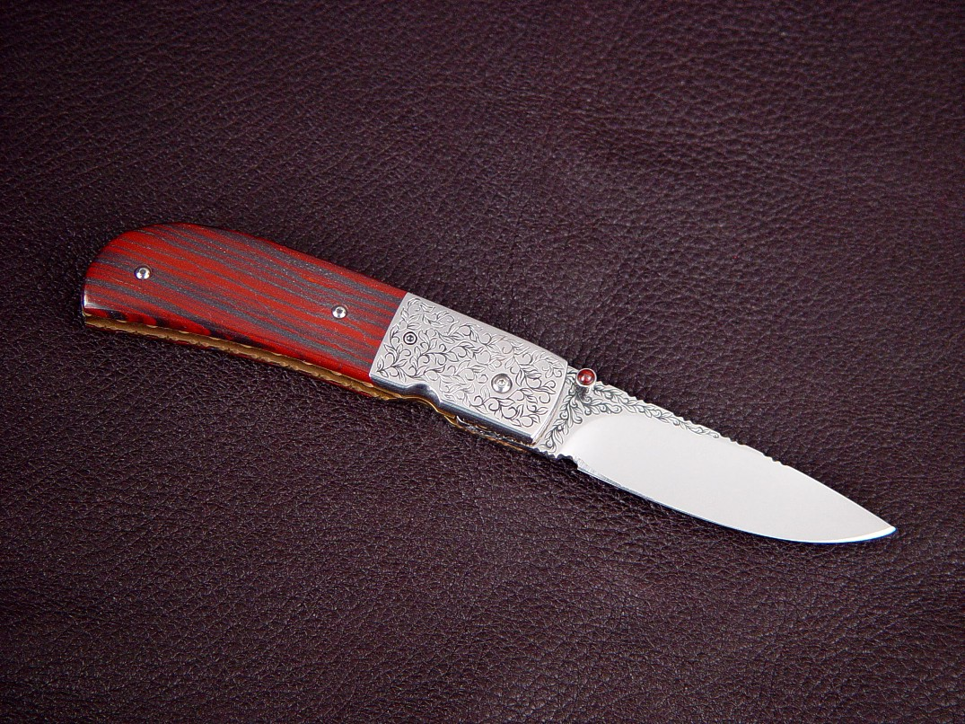 """Polaris"" linerlock folding knife, reverse side view: hand-engraved 440C high chromium stainless steel blade, 304 stainless steel bolsters, jasper and hematite gemstone handle, 6AL4V anodized titanium liners"
