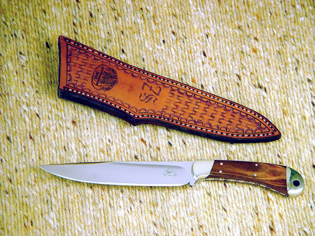 "Engraved leather sheath on ""Sanchez"" boning knife, commemorating Pararescue service. Sheath is basketweave tooled, hand-stitched"