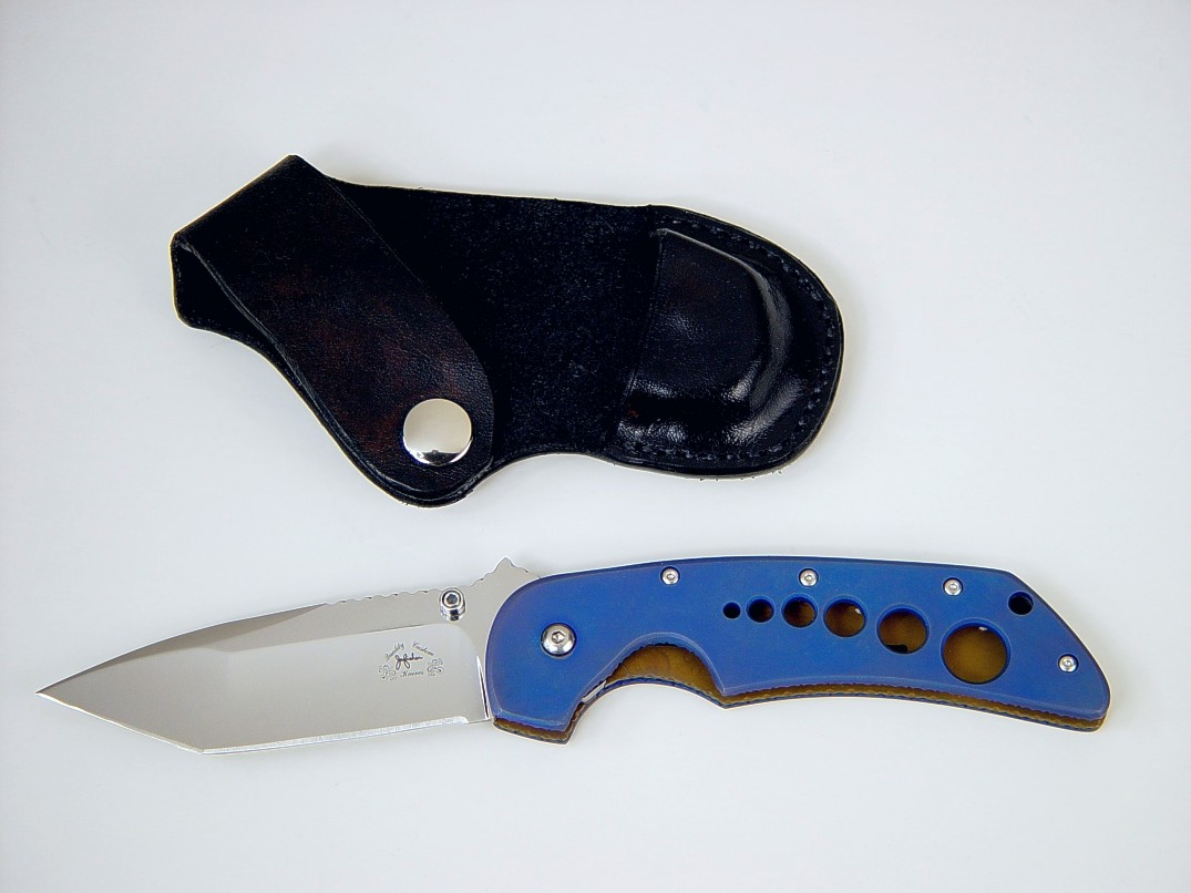 """Stratos"" liner lock folding knife, obverse side view: 440C stainless steel blade, anodized 6AL4V titanium liners, leather, nickel plated steel sheath"