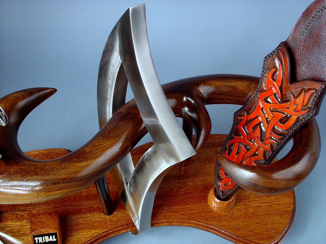 """Tribal"" (Helhor patten) knife sculpture, stainless triangle center, flowing lines of hand-carved American black walnut hardwood"